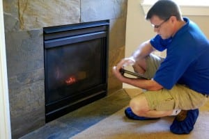 Keith Bowman inspects a fireplace in a new-construction home. Each Boggs Inspection Services inspector checks a new home from top to bottom in the same way they would an older home.