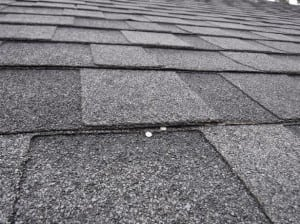 Small issues, such as these exposed roofing nails, can lead to big issues, such as roof leaks and rot, if not discovered during a home inspection.