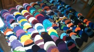 Hats covering Moran's living room floor. Photo courtesy of Bobbie Moran.